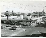 Exterior shot of the Hollywood Fred Meyer at NE Sandy and 42nd Avenue. includes a view of the roof parking lot and the Hollywood Theatre in the background. circa 1959. Coll 199 b12.f4