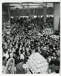 "Cake cutting at the Hawthorne store grand opening. Caption on back reads, ""Grand openings were always events. Glen Day cutting cake."" Coll 199 b13.f7"