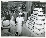 Interstate Fred Meyer grand opening celebration. Eva Meyer jokes wth the crowd and the cake baker.  Coll 199 b13.f10