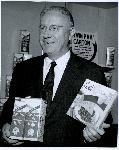 Earle A. Chiles poses with Eve's frozen cherry pie and MyTe-Fine Jersey Milk. Coll 199 b9.f5