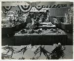Victory Garden show at Stadium Fred Meyer. Judges look over prize onions. Coll 199 b32.f22