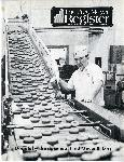 The cover of the employee newsletter shows the doughnut manufacturing facilities at the Fred Meyer central bakery. Coll 199 b27.f5