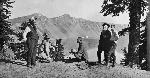 William Gladstone Steel's party at Crater Lake. From Left: Phil Metscham, Dr. Hill, Senator Fulton, Joaquin Miller, and Steel. OHS Research Library, Kiser Photo Co. photographs, Org. Lot 140, OrHi 101870
