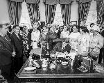 President John F Kennedy signing bill related to women's rights. OrHi 102853 bb015434