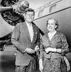 John F Kennedy and Edith Green next to airplane. Photo by Frank Sterrett. OrHi 47017 bb015440