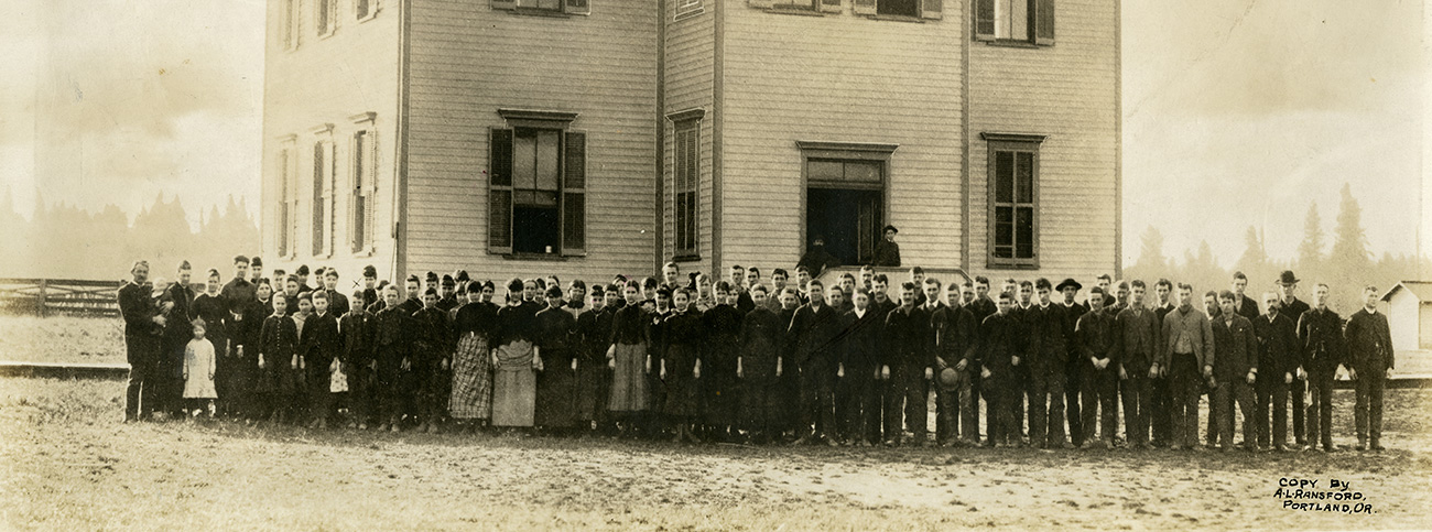 Herbert Hoover, Dr. John Minthorn and Laura Minthorn appear in this photo of Pacific Academy in front of the college building, 1885