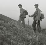 Herman Bohlman and William L. Finley hiking with their camera equipment packs up Mission Peak to photograph a golden eagle nest, 1904. Org. Lot 369, Finley A0427