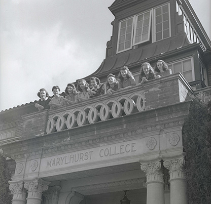 "Marylhurst College students on balcony of administration building. The unconfirmed note ""Marylhurst College students 3/17/44"" is written on the negative sleeve. Oregon Journal Negative Collection; Org. Lot 1368; Box 375; 375A0241"