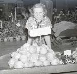 Vendor selling produce from The Dalles, Oregon. OHS Research Library, Oregon Journal Negative Collection; Org. Lot 1368; Box 372; 372A968