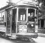 Car #700, Sellwood, with conductor standing at front window pointing straight. Portland General Electric Photograph Collection; Org. Lot 151; Box 19; PGE 129-22