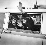 Ringo Starr and Paul McCartney of the Beatles wave from limo as the leave Portland Airport for the Coliseum. OHS Research Library, photograph by David Falconer, CN 015791, bb000807