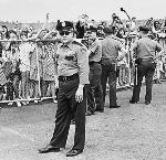 Multnomah Co. Sheriff's reservists keep eye on screaming crowd of Beatles fans at the Portland Airport, 08/08/1965. David Falconer, photographer. CN 015790, bb013127