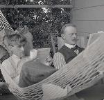 William L. Finley reclined reading in a hammock while Herman T. Bohlman reads in a chair nearby. William L. Finley Photographs Collection, circa 1900-1940; Org. Lot 369; b8; Finley A766